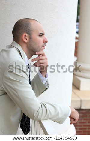 Attractive, Young Professional Mature Businessman Man Thinking and Contemplating