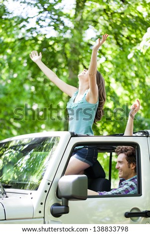 Attractive young romantic couple enjoying in ride through the forest. - stock photo