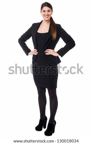 Attractive young secretary in formal attire, full length portrait. - stock photo