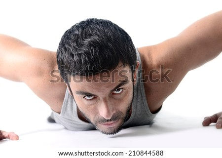 attractive young sport man training his body doing push up exercise isolated on white background - stock photo
