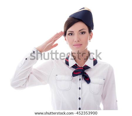 attractive young stewardess saluting isolated on white background - stock photo