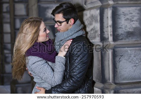 Attractive young stylish couple in love dressed in warm cloths outdoors
