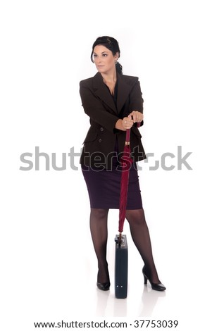 Attractive young successful female businesswoman with briefcase.  studio shot.