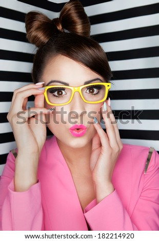 Attractive young surprised woman wearing glasses on stripy background, beauty and fashion concept  - stock photo