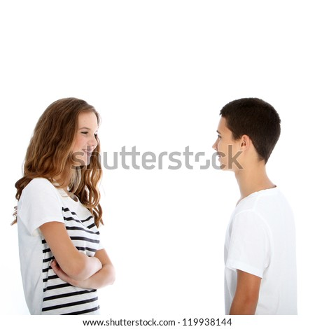 Attractive young teenage boy and girl standing sideways facing each other chatting isolated on white