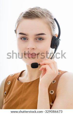 Attractive Young Telephonist at Work Taking Calls or Marketing Products Isolated Against a Plain White Background