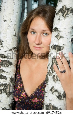 attractive young tired woman near by birch - stock photo