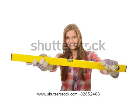 Attractive young trainees with work gloves shows her bubble level - stock photo