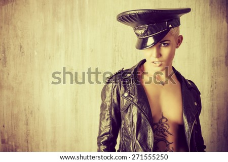 Attractive young woman alluring in a costume of police officer. - stock photo