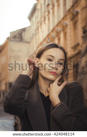 Attractive young woman at the city street. Closeup shot - stock photo