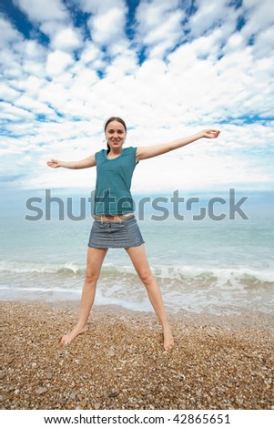 Attractive young woman at the sea - stock photo