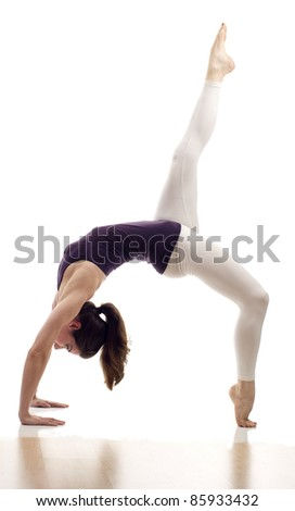 Attractive young woman backbend with leg in the air isolated over white background - stock photo