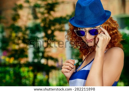 Attractive young woman beautiful foxy hair outdoors. Beauty, fashion. - stock photo