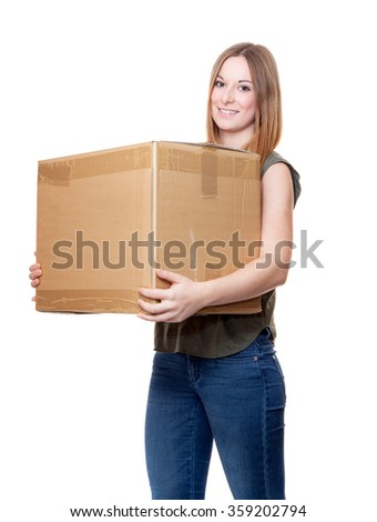 Attractive young woman carrying moving boxes.
