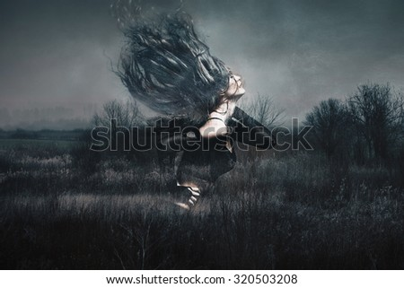 attractive young woman dancing long hair fly, double exposure