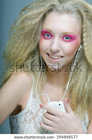 Attractive young woman dancing to music on her headphones