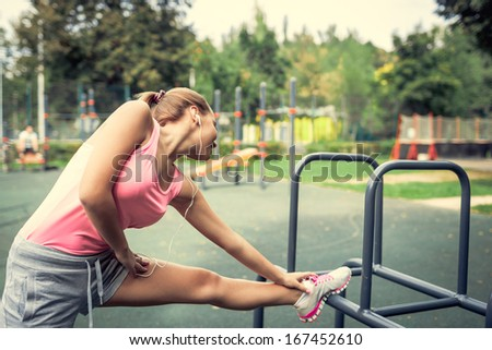 Attractive young woman doing stretching - stock photo
