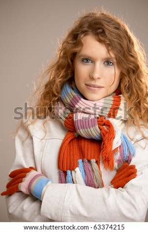 Attractive young woman dressed up warm in scarf, gloves and coat.? - stock photo