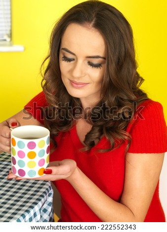 Attractive Young Woman Drinking a Mug of Tea