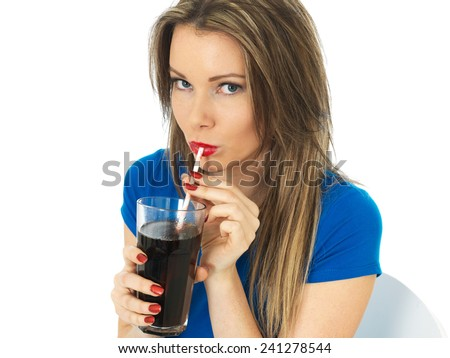 Attractive Young Woman Drinking Fizzy Cola Drink - stock photo