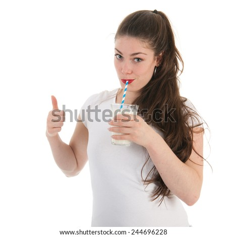 Attractive young woman drinking glass of milk - stock photo