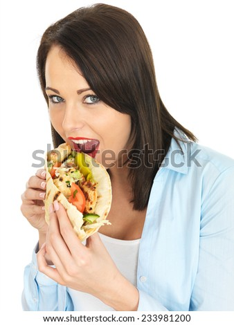 Attractive Young Woman Eating Chicken Kebab with Salad - stock photo