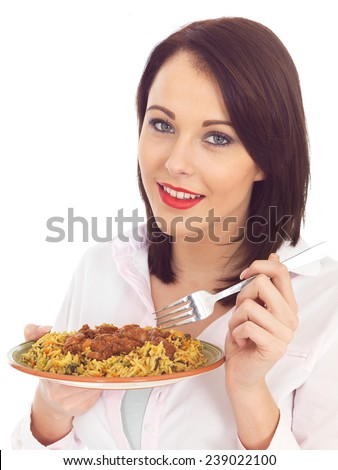 Attractive Young Woman Eating Lamb Rogan Josh Indian Curry - stock photo