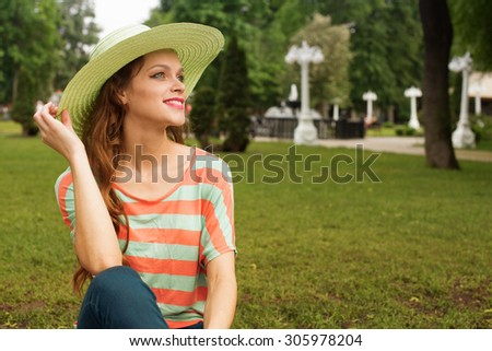 Attractive young woman enjoying her time outside in park