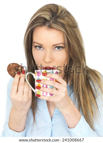 Attractive Young Woman Enjoying Tea and Biscuits