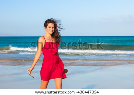 Attractive young woman enjoying the ocean beach