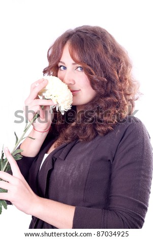 Attractive young woman face with great smile and flower.