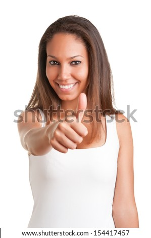 Attractive young woman giving the thumbs-up, isolated on a white background