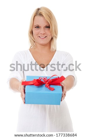 Attractive young woman hands over present