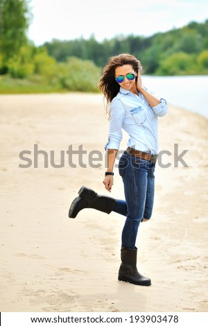 Attractive young woman having fun outdoors - full length portrait  - stock photo