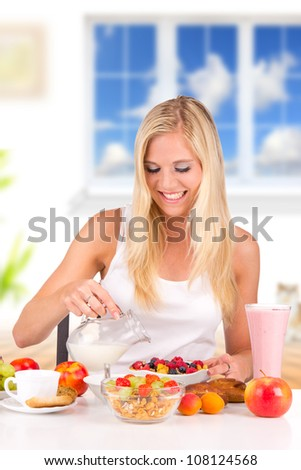Attractive young woman having healthy breakfast