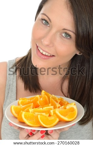 Attractive Young Woman Holding a Plate of Sliced Fresh Juicy Oranges Segments - stock photo