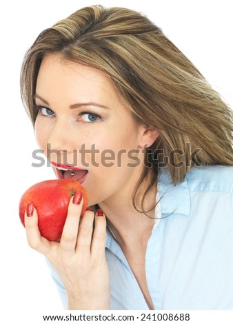 Attractive Young Woman Holding a Ripe Juicy Red Apple - stock photo