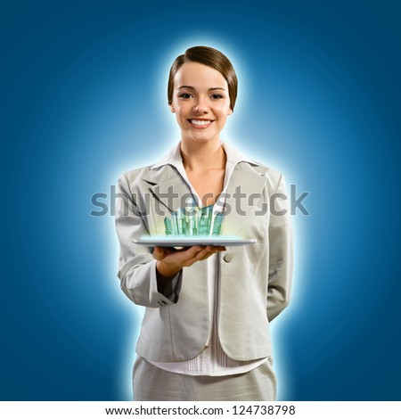 attractive young woman holding a tablet, it is a city, the concept of digital technology - stock photo
