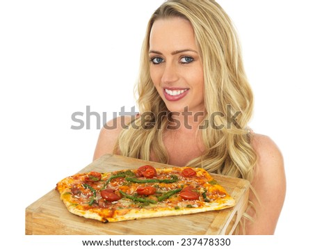 Attractive Young Woman Holding a Whole Pizza - stock photo