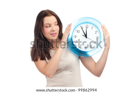Attractive young woman holding big clock, over white background
