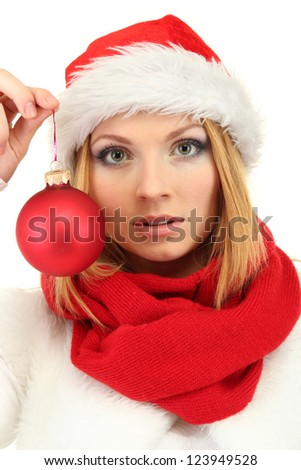 Attractive young woman holding Christmas ball isolated on white