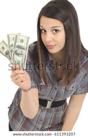 Attractive young woman holding dollar bills in front of white background