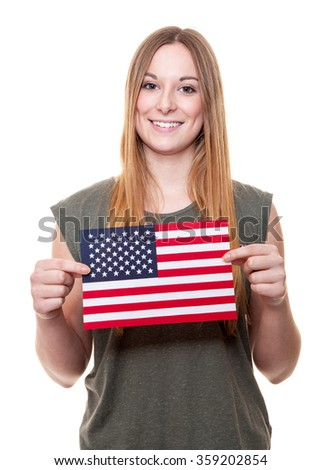 Attractive young woman holding flag of the USA