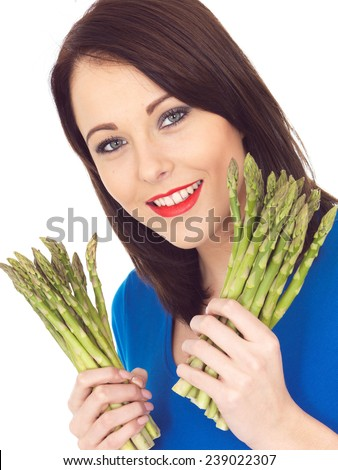 Attractive Young Woman Holding Fresh Asparagus