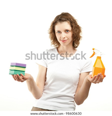 Attractive young woman/housewife holding cleaning supplies; housekeeping concept on white background - stock photo
