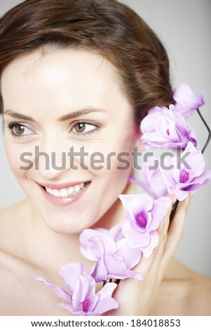 Attractive young woman in a beauty style pose.