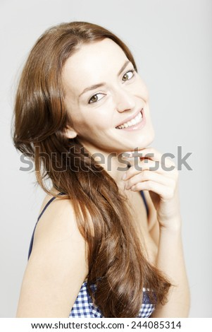 Attractive young woman in a beauty style pose with long brown hair - stock photo