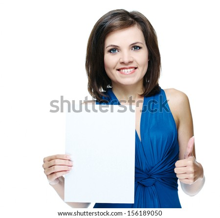 Attractive young woman in a blue dress. Holds a poster and showing thumbs up. Isolated on white background