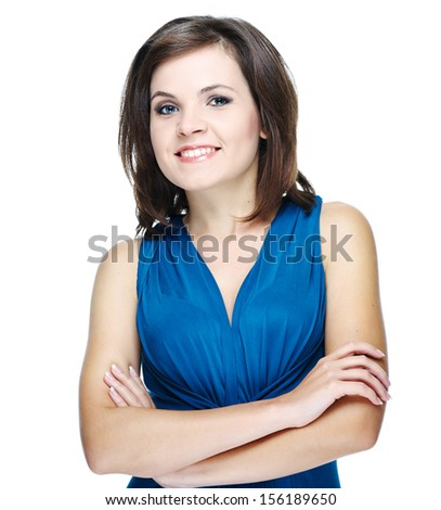 Attractive young woman in a blue dress. Standing with folded hands. Isolated on white background