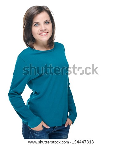 Attractive young woman in a blue shirt and jeans. Isolated on white background